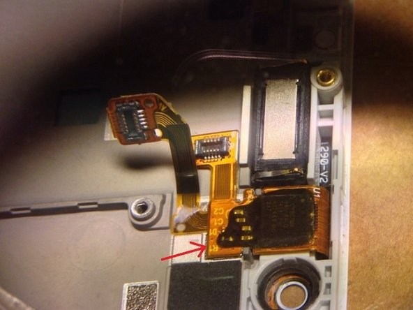 Remember to peel up the digitizer flex cable, as it is glued to the proximity sensor, and might cause damage when removing the front panel, should you forget it.