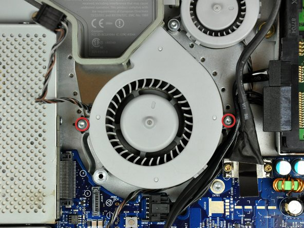 Remove the two T8 Torx screws securing the upper left fan to the chassis.