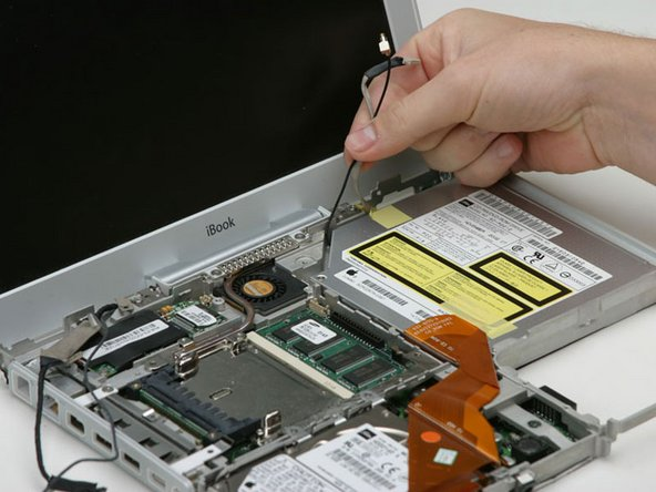 Carefully deroute the inverter cable from beneath the optical drive.