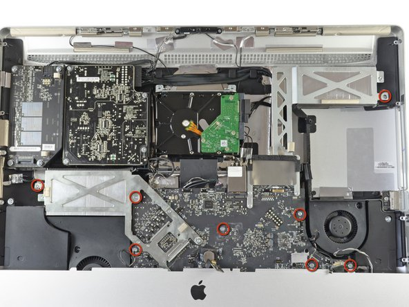Remove the eight T10 Torx screws securing the logic board and heat sink assembly to the iMac case.