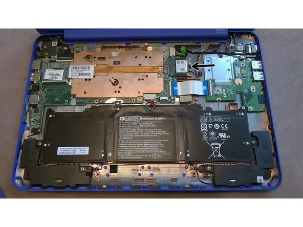 The  WiFi/Bluetooth mPCIe card is located to the right of the  motherboard, highlighted with the arrow.