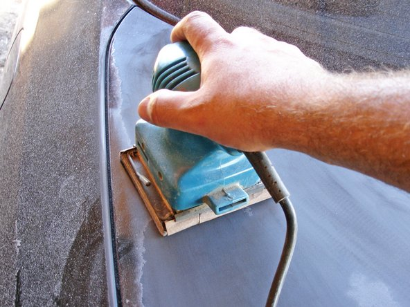 Use a power sander with a low-grit sand paper to strip the old paint off the surface of your vehicle. Use a sanding block or just the sand paper to reach small or hard-to-get places.