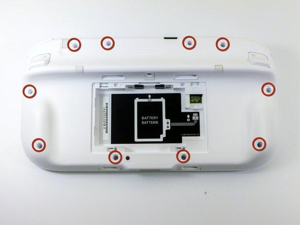 Enlevez les dix vis Tri-wing Y1 de 8,9 mm, cachées sous les autocollants carrés blancs.