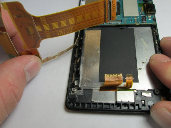 The final step is taking the entire harness off of the phone.