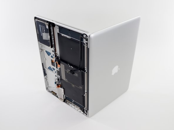 Open your MacBook Pro and set it on a table as shown.