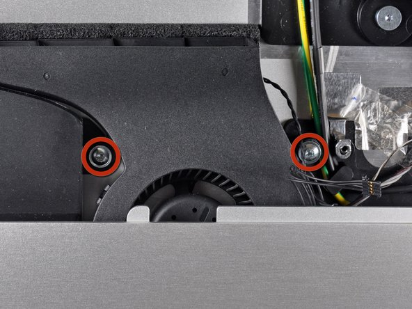 Remove the two 13 mm T10 Torx screws securing the CPU fan to the outer case.