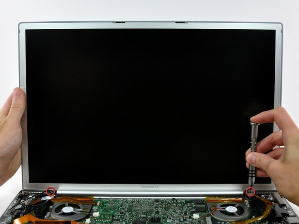 While supporting the display with one hand, remove the one remaining T6 10 mm Torx screw from each display bracket (two screws total).