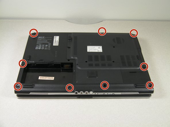 Remove the nine screws from the back edges of the laptop.
