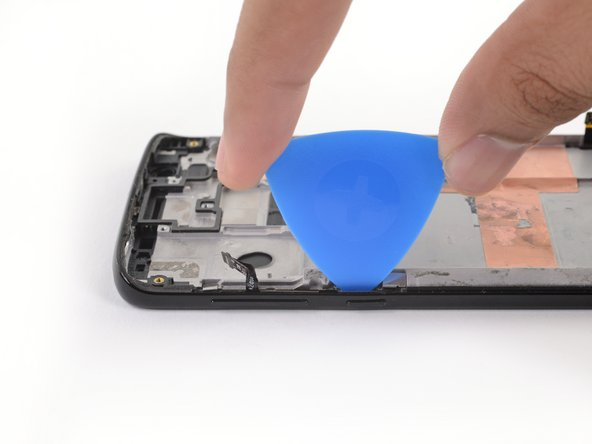 Insert an opening pick between the power and volume button circuit board and the frame.