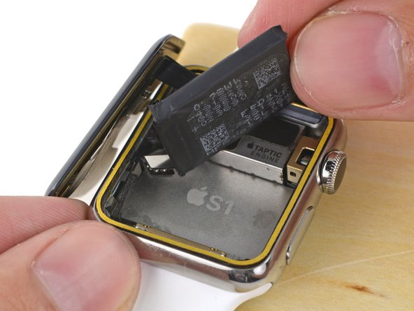 If you're using a replacement battery that came with pre-installed adhesive, peel off the protective tab now, exposing the adhesive.