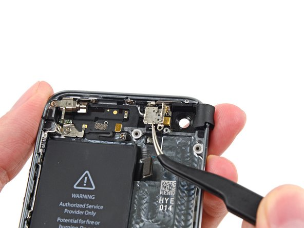 Remove the rear-facing camera bracket from the rear case.