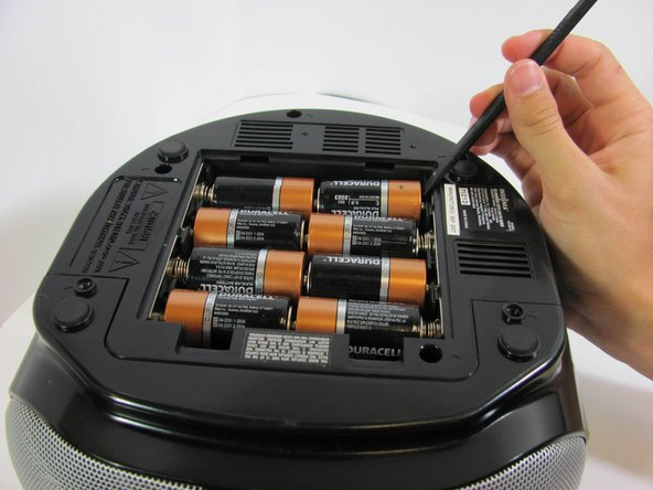 Using a spudger or your fingers, push up against the positive end of the battery. Once it is loose, lift the battery out.