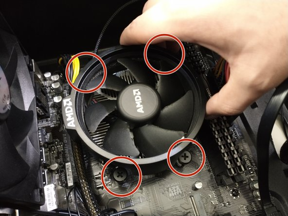 Place the CPU cooler on top of the CPU and using a Phillips #0 screwdriver to tighten the four 10 mm screws in place.