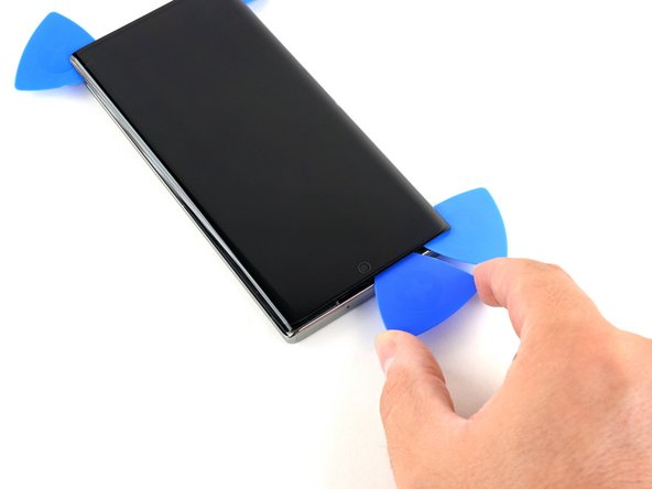 Insert a fourth opening pick into the gap on the top edge of the phone.