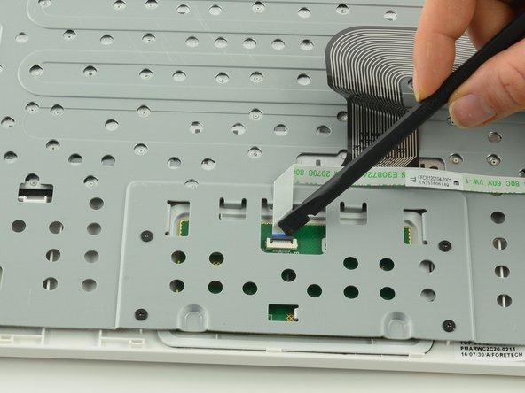Use a spudger to lift up the black retaining flap on the touchpad's ZIF connector.