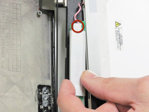 Turn the inverter over to expose the white clip.