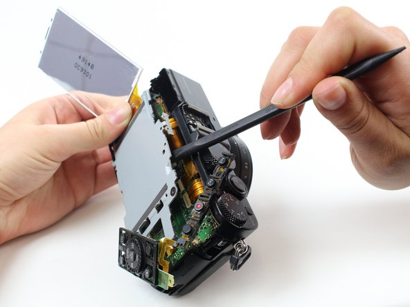 Lift the LCD screen away from the device.