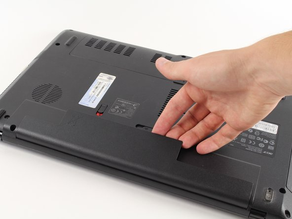 Now remove the battery by lifting it out of the laptop by the side closest to the switches.