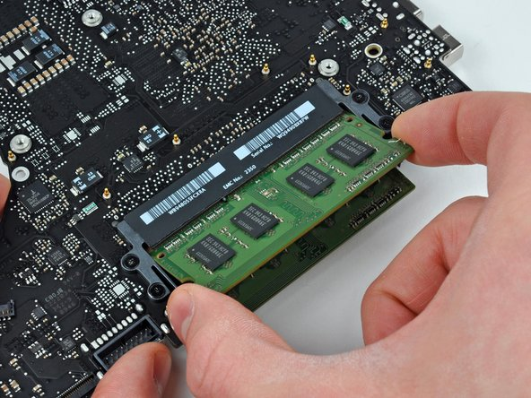 After the RAM chip has popped up, pull it straight out of its socket.