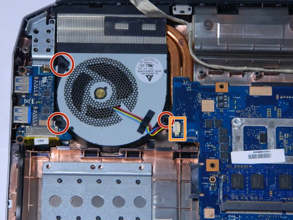Remove the second fan by unscrewing the three black screws circled in the picture in red.