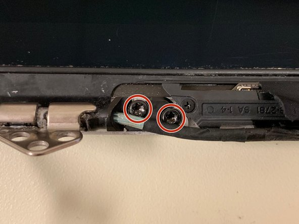 Remove the two screws securing the cable to the case: