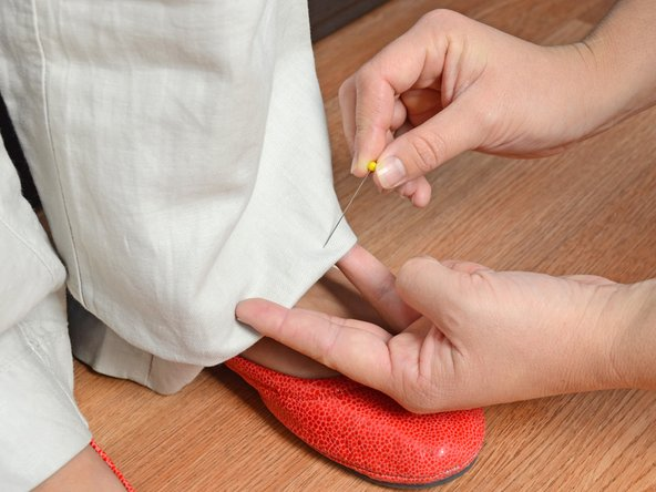 Fold the cuff of one pant leg inward, and adjust it to the desired length.