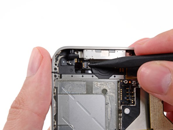 Use the tip of a spudger or your fingernail to flip up the home button ribbon cable retaining flap.