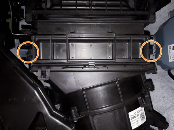 The cabin air filter can be accessed by removing the cover from the filter housing.
