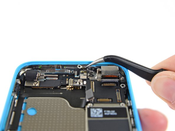 Use tweezers to remove the logic board grounding clip.