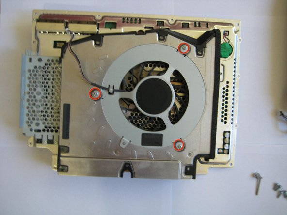 Remove the 3 Philips #2 screws holding the fan to the main body.