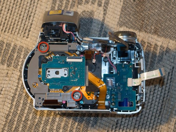 The next two screws hold the lens and sensor module