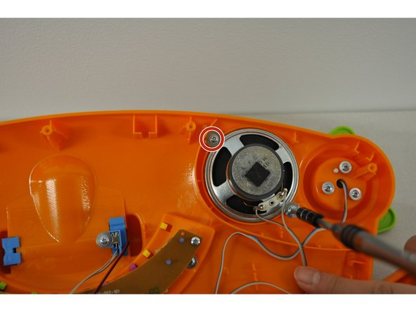 In the top right corner inside the device,  unscrew the 2 PH2 screws (5 mm) holding the speaker in place.