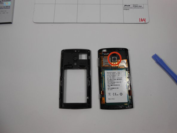 Once the clips are undone the back casing should dislocate and reveal the internal components of the phone. Camera location is identified on the image.