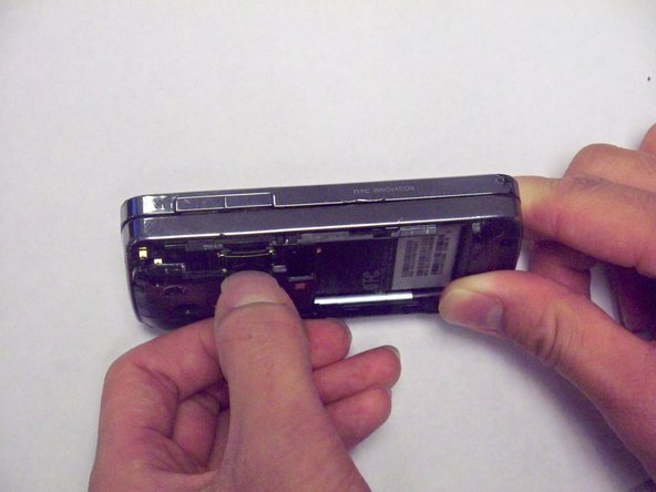 Lift the plastic cover near the memory card slot.