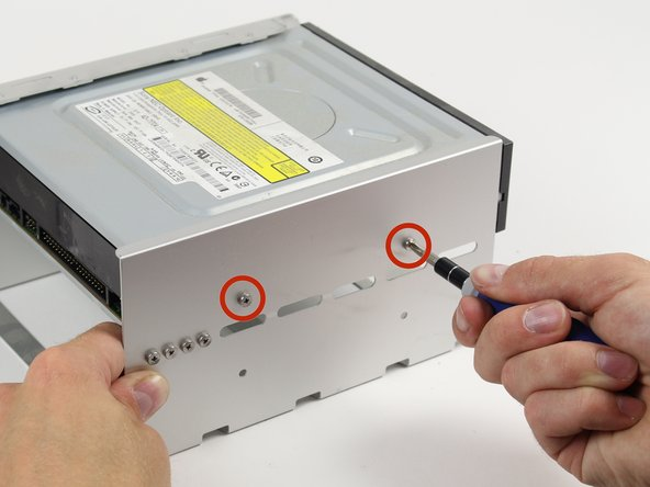 Unscrew the shown two 6-32 type screws on each side of the optical drive.