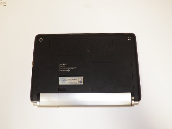 Flip laptop over to back with the battery facing downwards.