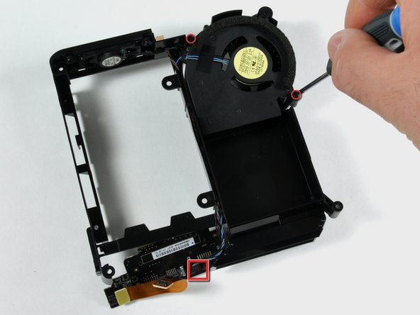 Remove the two screws holding the fan in place.