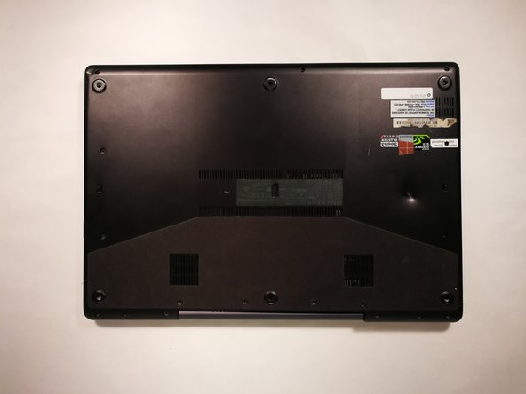 Locate and remove all screws securing the back plate. Place the screws on the magnetic mat.