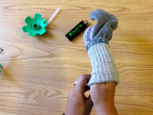 Place the sock over your hand like a glove.