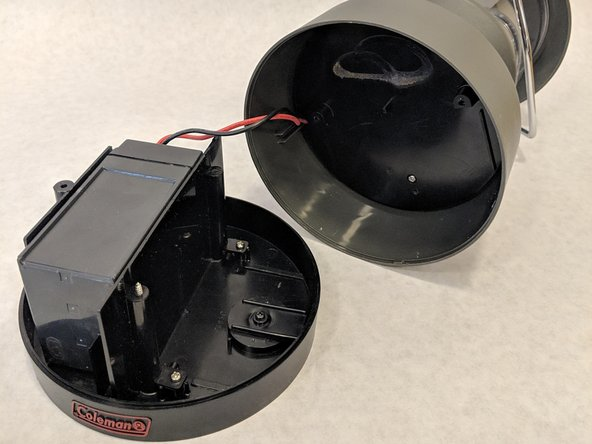 Carefully pull the bottom of the lantern to remove the base from the device.