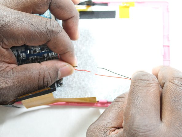 After creating space to work, warm up a soldering iron.