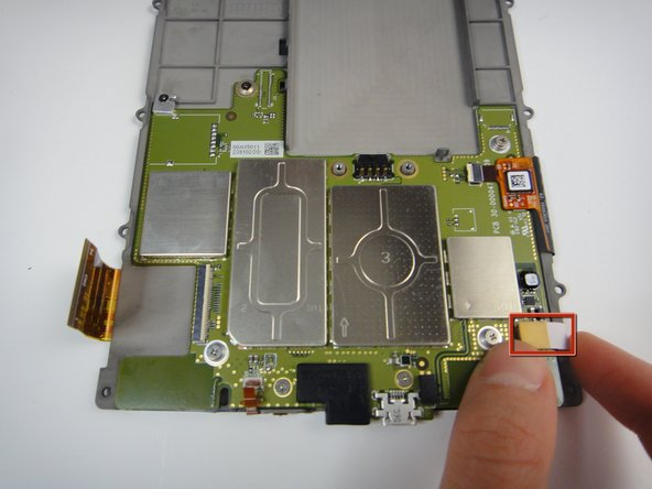Remove the white flex cable by gently lifting the yellow plastic connector.