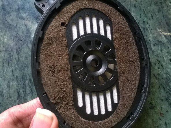 By feel, locate 4 screws under the foam, 2 each side.