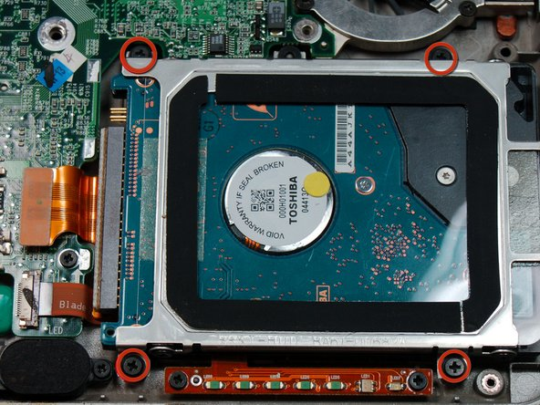 Remove the 4 #00 5 mm screws holding the hard drive to the case.