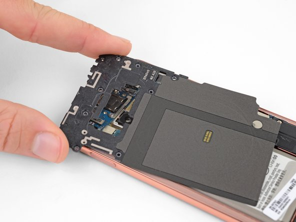 Lift the midframe by the plastic section and remove it from the phone.