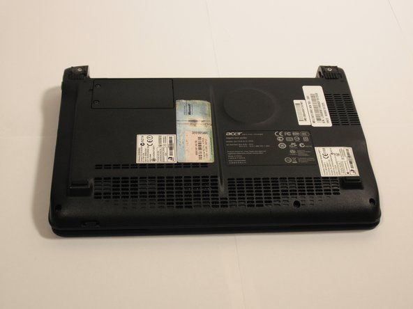 Turn the netbook upside down with the battery at the top, facing away from you.