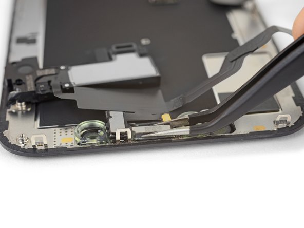 Use tweezers to wiggle the ambient light sensor and lift it from its notch in the display.