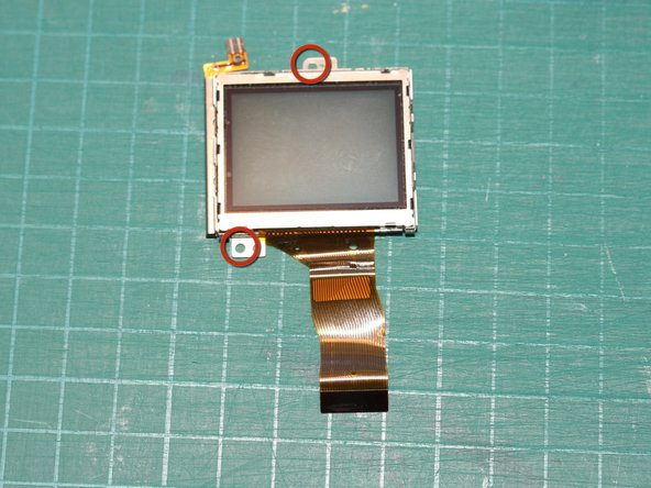 Remove the 2 screws holding the LCD display module (already removed from the rest of the camera in this photo)