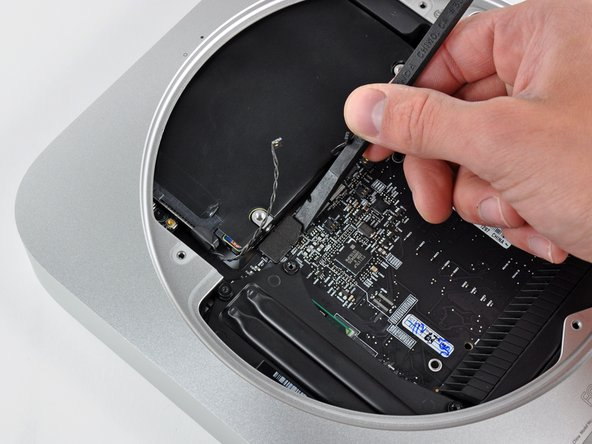 Use the flat end of a spudger to pry both the hard drive and optical drive connectors up out of their sockets on the logic board.