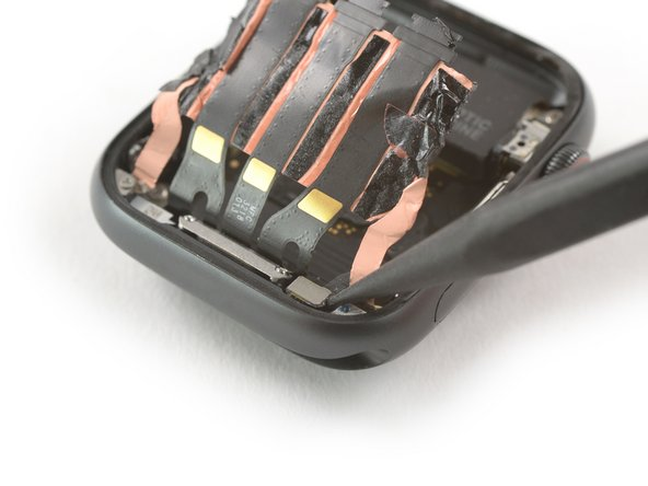 Use the pointed end of a spudger to pry the Force Touch gasket connector out of its socket.